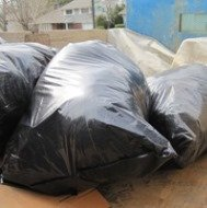 Moldy materials being removed in double plastic bags